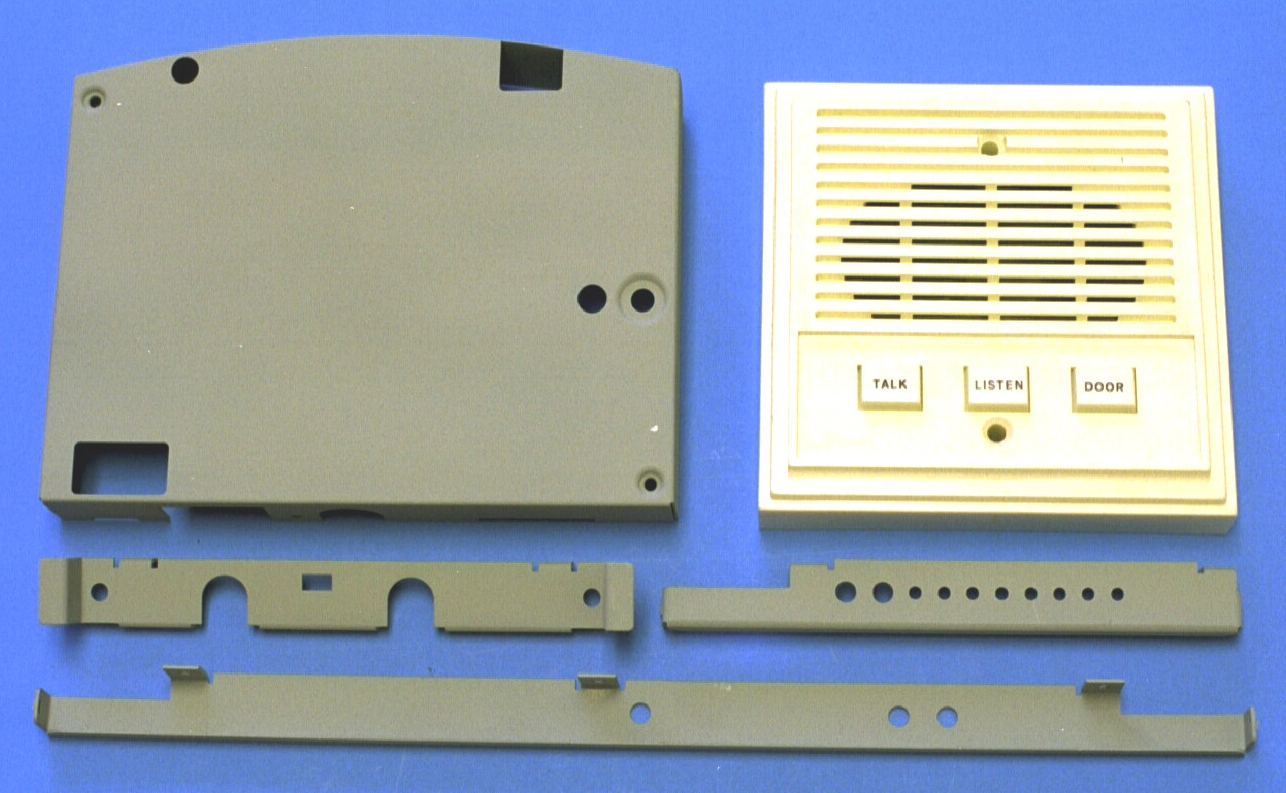 Metal stampings of telecommunications stampings and a plastic molded speaker grill
